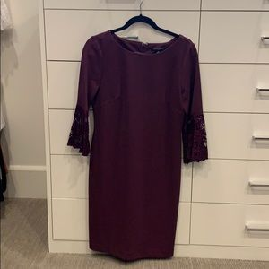 Cute plum dress with bell lace sleeves.